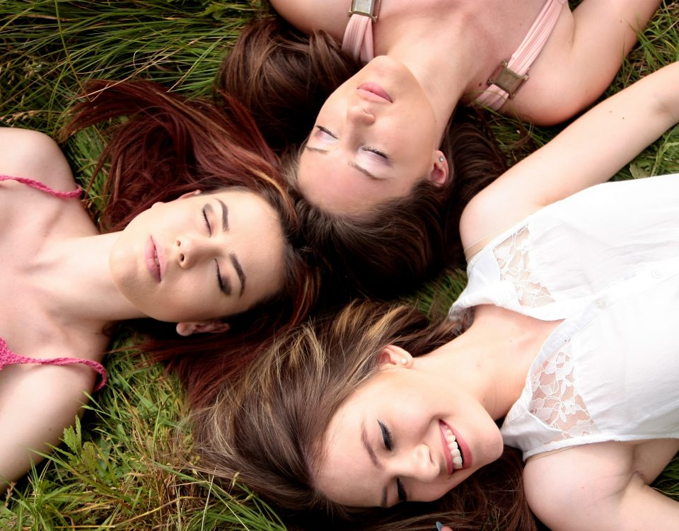 3 girls laying down